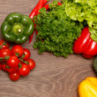 Stock Photo: Tomatoes, paprikand other vegetables on wooden surface