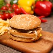 Stock Photo: Burger and fries on chopping board