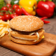 Foto de Stock  : Burger and fries on chopping board