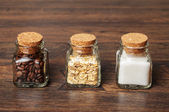 Three jars of coffee, oats and sugar — Stock Photo