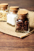 Mini jars of coffee, sugar and oats — Stock Photo