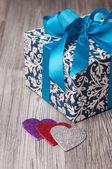 Romantic patterned blue gift box — Stock Photo