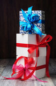 Three gift boxes of different color — Stock Photo