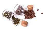 Two jars of coffee beans and tea — Stock Photo