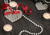Tealights and pearl beads in a romantic setting — Stock Photo
