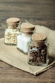 Three jars with coffee, sugar and oats — Stock Photo