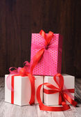 Two white boxes and a pink one on the top — Foto Stock
