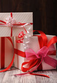 Three boxes with different ribbons — Stock Photo