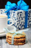 Cookies, white cup and a blue gift box — Stock Photo