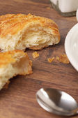 Two pieces of a flaky croissant — Stock Photo