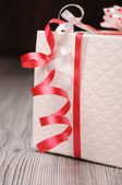 Fragment of a gift box and red ribbons — Stock Photo