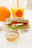 Takeaway poppyseed and sesame mozarella bun — Stock Photo