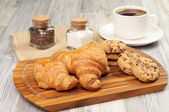 Some pastries and a cup of black coffee — Stock Photo
