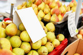 Pears stacked on a market stoll — Stock Photo
