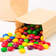 Two paper bags with color candies — Stock Photo