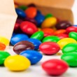 Colorful hard candies in a paper bag — Stock Photo