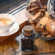 Stock Photo: Cookies in a jar and a cup of tea on a windowsill