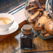 Cookies in a jar and a cup of tea on a windowsill — Stock Photo