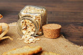 Oats in a jar on a sack cloth — Stock Photo