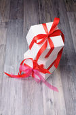 Two present boxes with red ribbons — Stock Photo