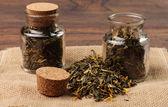 Tea jars on a sack cloth napkin — Foto Stock