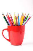 Color pencils in a red mug — Stock Photo
