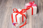 Two romantic gift boxes on a wooden surface — Стоковое фото