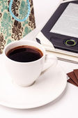 A cup of coffee and a tablet pc — Stock Photo