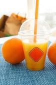Fresh orange juice to go — Stock Photo
