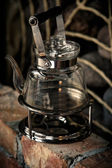 A glass kettle on a camping burner — Stock Photo