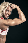Powerful bodybuilder smiling — Stock Photo