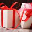 Two white and red gift boxes on the floor — Stok fotoğraf