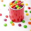 Chocolate colorful candies in a red jar — Stok fotoğraf