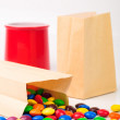 Different color candies in paper bags — Stock Photo