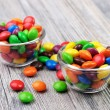 Stock Photo: Colorful coated chocolates in two glass bowls