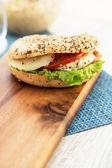 Mozarella and tomato bun with seeds — Zdjęcie stockowe