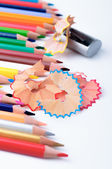 Sharpening different color pencils in a studio — Stock Photo
