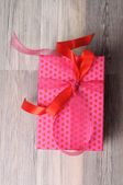Romantic gift box with a heart pattern — Stock Photo
