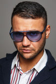 Portrait erious man wearing violet sunglasses — Foto Stock