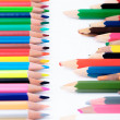 Stock Photo: New and old color pencils in front of each other
