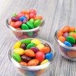 Three glass bowls with crunchy sweeties — Stock Photo