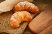 Two croissants on a linen cloth — Stock Photo