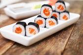 Salmon sushi set on a white plate — Zdjęcie stockowe