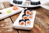 Salmon sushi set on a wooden table — Stock Photo