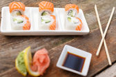 Deluxe sushi with salmon with full set — Stock Photo