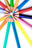 Colorful and golden pencils pointing to one point — Foto Stock