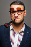 Portrait of a smoker with a pipe in double sunglasses — Foto Stock