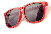 Red plastic sunglasses — Stock Photo