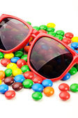 Candies and sunglasses — Stock Photo