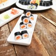 A set of sushi on a wooden table — Stock Photo